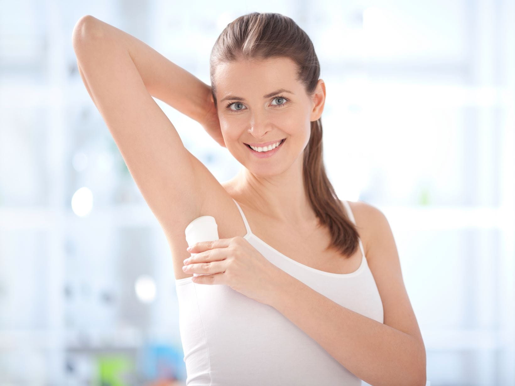 woman-in-bathroom-with-deodorant